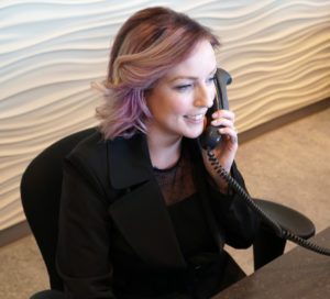 Receptionist answering phone for dental appointment | South Family Dental